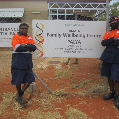 Intract employees standing infront of the AMATA Family wellbeing Centre PALYA