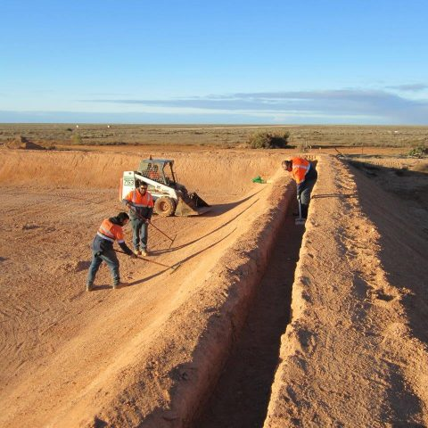 Intract employees digging trenches for the sewer pond remediation at the Cook Dump