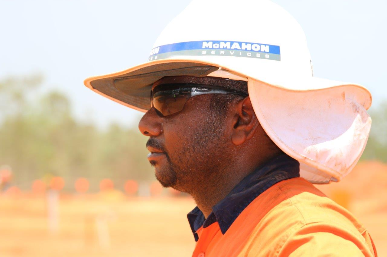 Intract contractor profile view wearing safety hat and glasses
