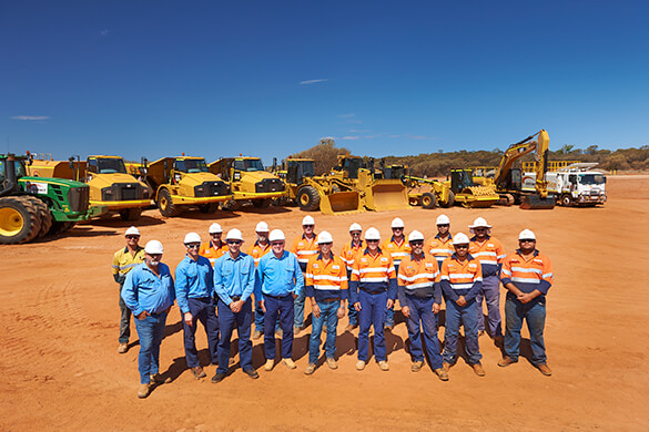 Intract contractors and leaders standing together at construction site